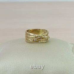14k wide artisan yellow gold multi row crossover ring with diamond accents
