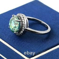 3 Ct Certified Blue Diamond Ring With A Halo Of White Accents in Black Gold
