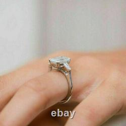3ct Emerald Cut Diamond Trilogy Ring 14k White Gold Over Tapered Baguette Accent