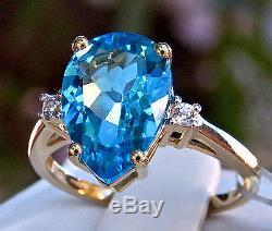 4.69ct Genuine Swiss Blue Topaz Solitaire withAccents 10k Yellow Gold Ring, Size 7