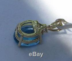 6.21 cts Genuine Swiss Blue Topaz Pendant in 10k Yellow Gold withAccent