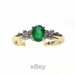 Emerald Oval 6x4mm in Ring with Diamond accents in 14kt. Yellow Gold