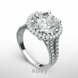 Halo Diamond Ring Si2 18 Karat White Gold Certified Colorless 4 Carat Accents