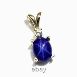 Lab Blue Star Sapphire 8x6mm Oval Cabochon with Accent 14KT Yellow Gold Pendant