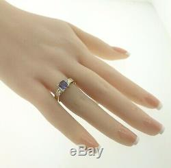 Natural cushion-cut tanzanite solitaire diamond accent ring in 14k yellow gold