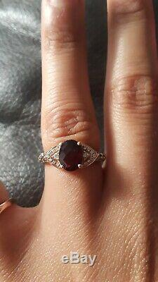 Oval Rhodolite Garnet Levian ring with accent chocolate diamonds 14k rose gold