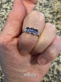 Tanzanite And Diamond Accent Ring 14 Kt Yellow Gold