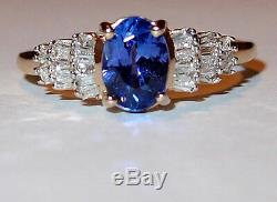 Tanzanite solitaire with Diamond accents, 1.00ct, in 9k Yellow Gold. Size K